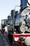 View of an ancient steam locomotive against the background of cl Stock Image