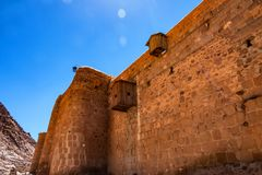 Wall of Saint Catherine`s Monastery, Egypt. View of ancient stone walls of Saint Catherine`s Monastery in Sinai Peninsula, Egypt. It is the oldest working stock images