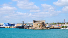 View on the ancient tower in the port of Civitavecchia, Italy. Stock Photography