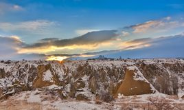 View of ancient Uchisar cave town and a castle of Uchisar dug from a mountains in Cappadocia, Central Anatolia,Turkey. Winter time with sun Royalty Free Stock Images