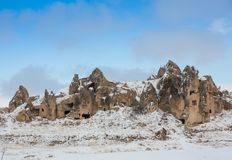 View of ancient Uchisar cave town and a castle of Uchisar dug from a mountains in Cappadocia, Central Anatolia,Turkey. Winter time with sun Royalty Free Stock Photo
