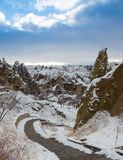 View of ancient Uchisar cave town and a castle of Uchisar dug from a mountains in Cappadocia, Central Anatolia,Turkey. Winter time with sun Stock Images