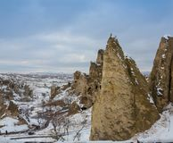View of ancient Uchisar cave town and a castle of Uchisar dug from a mountains in Cappadocia, Central Anatolia,Turkey. Winter time with sun Stock Photo