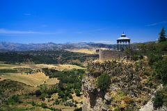 View on ancient village Ronda located on plateau surrounded by rural plains in Andalusia, Spain royalty free stock images