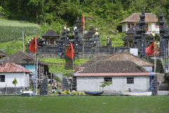 View of the ancient village Trunyan and Hindu Temple from Lake Batur, Bali Royalty Free Stock Image