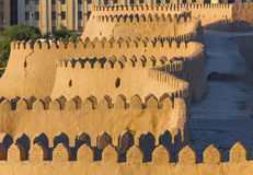 View of the ancient wall of Khiva, in Uzbekistan. View of the ancient wall of Khiva from the watchtower of the Khuna Ark, the fortress and residence of the stock photo