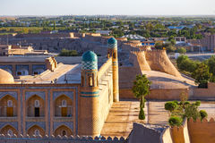 View of the ancient wall of Khiva, in Uzbekistan. View of the ancient wall of Khiva from the watchtower of the Khuna Ark, the fortress and residence of the stock photography