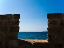 View through the ancient wall to the sea Royalty Free Stock Photo
