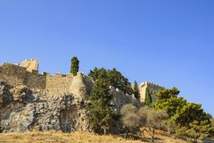 A view of the ancient walls and towers of the acropolis of Lindos. Rhodes Island, Greece Stock Photos