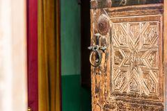 Old door of Saint Catherine`s Monastery, Egypt. View of ancient wooden door in it in Saint Catherine`s Monastery in Sinai Peninsula, Egypt. It is the oldest royalty free stock photo