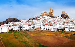 View of  andalusian town with church and  castle. Olvera Royalty Free Stock Photo