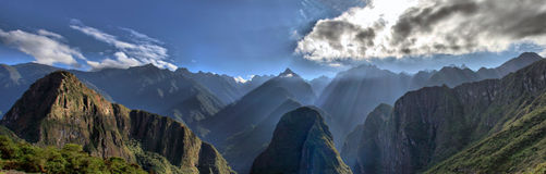 View of Andes Mountain Range - Machu Picchu. View of Andes Mountain Range from Machu Picchu. Beautiful scenery with Sun Rays shining through the Mountains Peaks Royalty Free Stock Photography