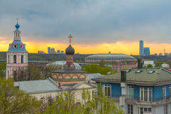 View on the Andreevsky convent and Luzhniki stadium on the sunset Stock Photography