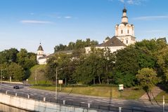 View of the Andronikov Monastery and roadway of the river Yauza quay on the clear summer evening, Moscow, Russia. In the fussy noisy Moscow sometimes you want royalty free stock photo