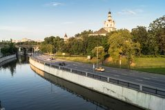 View of the Andronikov Monastery and roadway of the river Yauza quay on the clear summer evening, Moscow, Russia. In the fussy noisy Moscow sometimes you want stock images