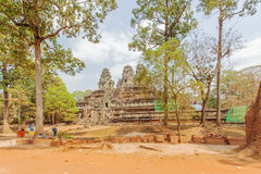 View of Angkor, Siem Riep, Cambodia. View in Angkor area, Siem Riep, Cambodia. The lake in front of the Angkor Wat where tourist commonly stand here to take Royalty Free Stock Photo
