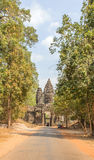 View of Angkor, Siem Riep, Cambodia. View of big road in Angkor area, Siem Riep, Cambodia. The lake in front of the Angkor Wat where tourist commonly stand here Stock Photo