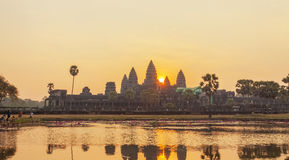 View of Angkor, Siem Riep, Cambodia. View of dawn in Angkor area, Siem Riep, Cambodia. The lake in front of the Angkor Wat where tourist commonly stand here to Stock Photo