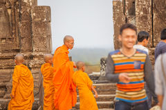 View of Angkor, Siem Riep, Cambodia. Sunshine, Monks in Angkor area, Siem Riep, Cambodia. The lake in front of the Angkor Wat where tourist commonly stand here Royalty Free Stock Photo