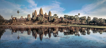 View of Angkor Thom temple under blue sky. Angkor Wat, Cambodia. Ancient Khmer architecture. Amazing view of Angkor Thom temple under blue sky. Angkor Wat Stock Image