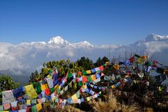 View of Annapurna Mountain with Praying Flags. Annapurna Mountain taken at Poon Hills view point royalty free stock photos