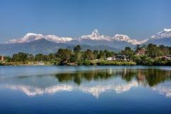 View at Annapurna mountain range and its reflection in Phewa lak Royalty Free Stock Photo