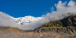 View of the Annapurna Range, from Annapurna Base Camp, Himalayas, Nepal. View of the Annapurna Range, from Annapurna Base Camp with light cloud, Himalayas, Nepal royalty free stock image