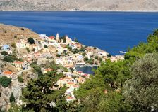 View of the Annunciation Church on the island of Symi and bay off Aegean sea. Greece stock photos