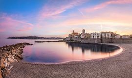View of Antibes on sunset from plage, French Riviera, France. Panoramic view of Antibes on sunset from Plage de la Gravette, French Riviera, France royalty free stock photo