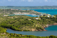 View of Antigua from Hills. Green Hills and Blue Water on the island of Antigua stock image
