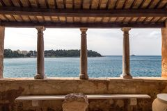 View through an antique building of Rovinj town on Adriatic sea. royalty free stock image