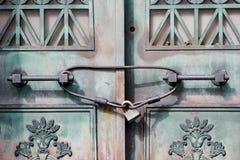 View of an Antique Door locked with Rustic Vintage Padlock. View of an old Antique Door locked with Rustic Vintage Padlock stock photo