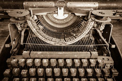 View of an antique manual Underwood typewriter. On sepia Stock Photography