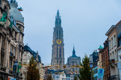 View of antwerp church and bell tower in cloudy rainy day stock photos