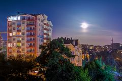 View of apartment buildings at full moon, Sochi, Russia royalty free stock photos