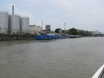 View of barges docked in an industrial area along the Pasig river, Manila, Philippines stock photography