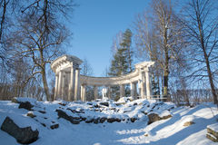 View of Apollo`s colonnade in the sunny February afternoon. Pavlovsk palace park. Royalty Free Stock Images