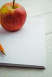 View of an apple and notepad Stock Image