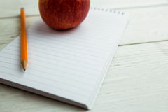 View of an apple and notepad Stock Photo