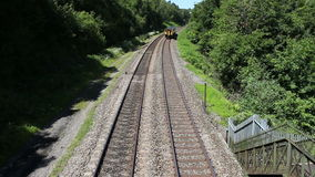 View of Approaching Train From Bridge stock video
