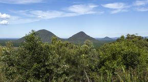 Glass House Mountains – Views from the Lookout. View from the aptly named Glass House Mountains Lookout towards, from left to right, to Tunbubudula royalty free stock photo
