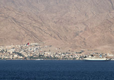 View on the Aqaba city and marine port, Jordan. Aqaba is a famous Jordanian resort city with the biggest marine port in Jordan Stock Photo