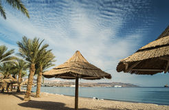 View on Aqaba and the Red sea. Sandy beach of Eilat - famous resort and tourist city in Isr Royalty Free Stock Photos