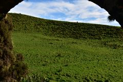 A View Through an Aqueduct on Sao Miguel. Scenic view of a field through an aqueduct on Sao Miguel royalty free stock photos