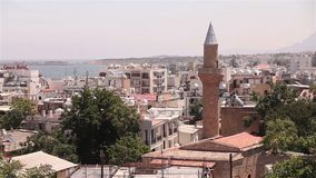 View of the Arab city by a mosque, The Arab city near the sea, the minaret in the Arab city, the Muslim, the Muslim city stock footage