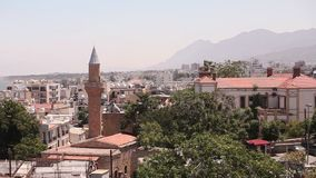 View of the Arab city by a mosque, The Arab city near the sea, the minaret in the Arab city, the Muslim, the Muslim city stock video footage
