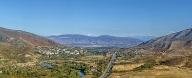 View of Aragvi river valley, Georgia. Panoramic view of Aragvi valley from Jvari Monastery hill, Georgia. On the horizon is visible Mount Kazbek Royalty Free Stock Images