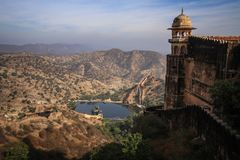 View of the Aravalli Hills, Water Tank and one of the towers of the Nahargarh Fort, Jaipur, Rajasthan, India. Nahargarh Fort stands on the edge of the Aravalli Royalty Free Stock Photo