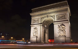 View of Arc de Triomphe at night. Stock Photos