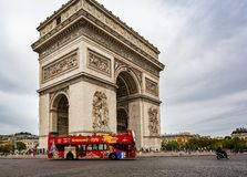 View of the Arc de Triomphe with red sightseeing bus from the Champs Elysees in Paris. France on 26 August 2018 stock image